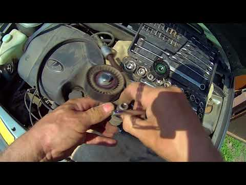 Как снять натяжной ролик ремня генератора калина