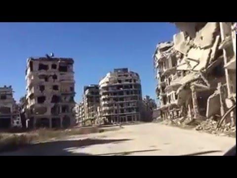Driving through the streets of Homs Syria شاهد حجم الدمار في حمص سوريا !!!