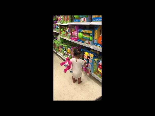 14 months old girl copying toy