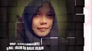 salib di balik jilbab voc. suci ramayanti