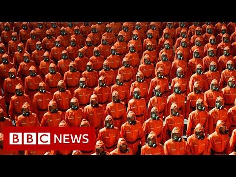 North Korea's military parade features hazmat suits and gas masks - BBC News