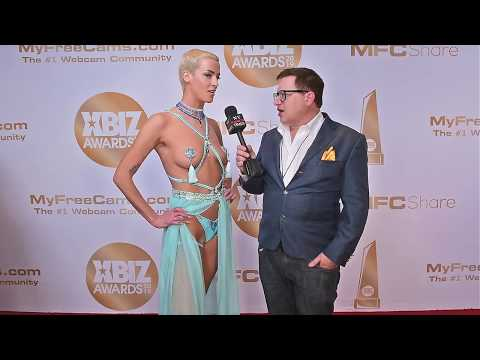 Laura X Desiree Of Naked News Is Interviewed On The Red Carpet At The 2019 Xbiz Awards