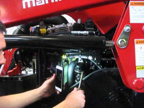 Where to add oil in a Mahindra 1500 series tractor