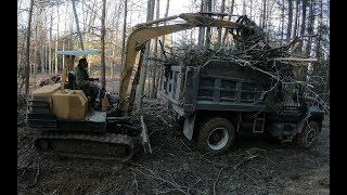 Hauling stone in and brush out