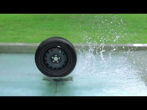 Fountain with the Car Wheel and Water Splashes. Slow Motion