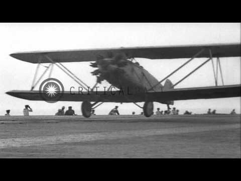 Aircraft carrier USS Langley (CV-1) at sea.  Aircraft taking off from the Carrier...HD Stock Footage
