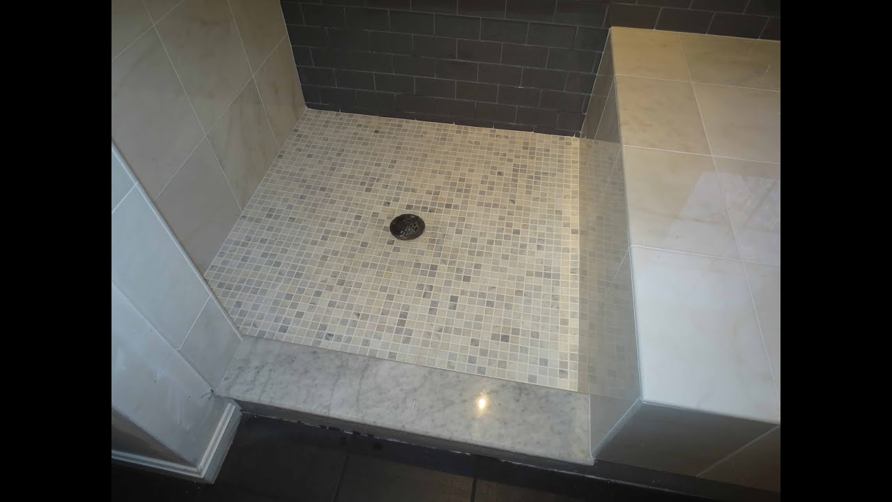 Complete bathroom install subway glass tile and Carrera marble ...
