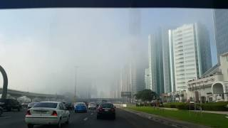 Driving on Sheikh Zayed Road in Dubai in the fog 05.12.2016
