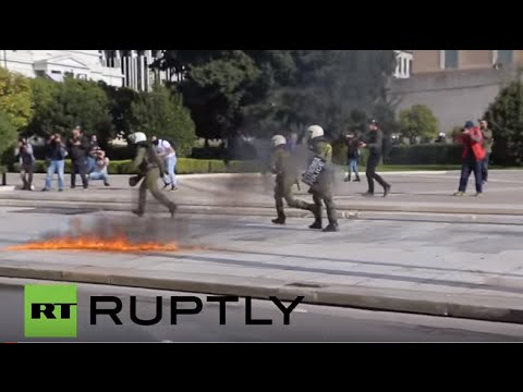Greece: Petrol bombs fly as thousands protest against austerity in Athens