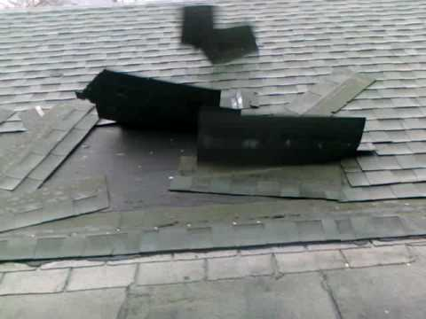 Wind ripping away roof shingles.