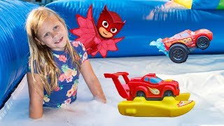 Assistant Plays with Paw Patrol in a Inflatable Bounce House Slip n Slide