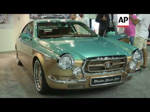 Handmade luxury cars alongside clics at car show - YouTube