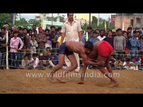 Rural mud wrestling by Indian boys