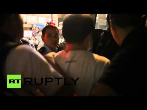 Clashes in Hong Kong as police storm protester camps