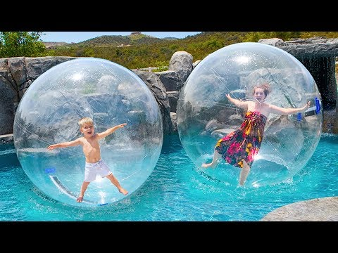 TRAPPED IN GIANT BUBBLE BALL! WALKING ON WATER IN NEW SWIMMING POOL!