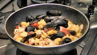 Italian Food Recipes. Gnocchi Dumplings with Ragout of Fish, Seafood and Vegetables