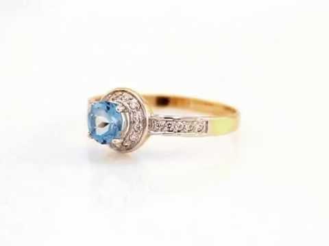 Яркие золотые кольца с голубым топазом K2591T 157