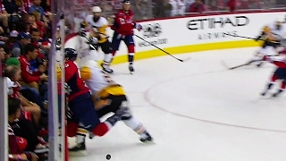 Cole brings down Wilson with vicious hit against boards