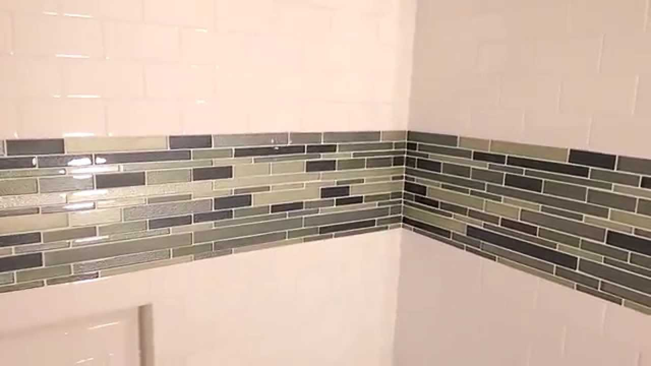 How to tile around a tub - YouTube