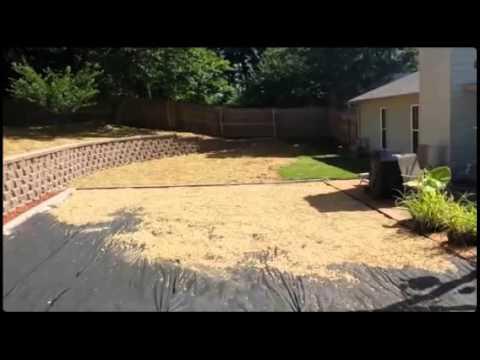 Retaining wall to level yard - YouTube