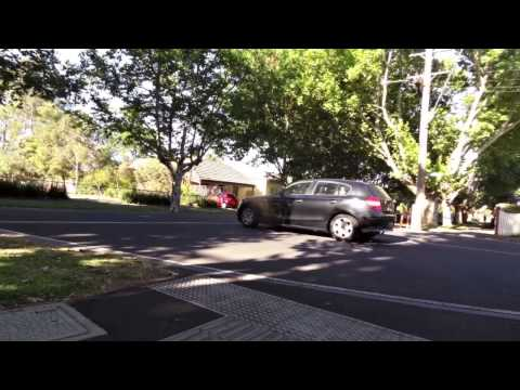 Fail to stop at a Stop Sign, Flemington Victoria, December 2014.