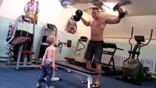 Adorable toddler works out with his dad