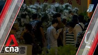 Two Hong Kong protesters charged with violating anti-mask law