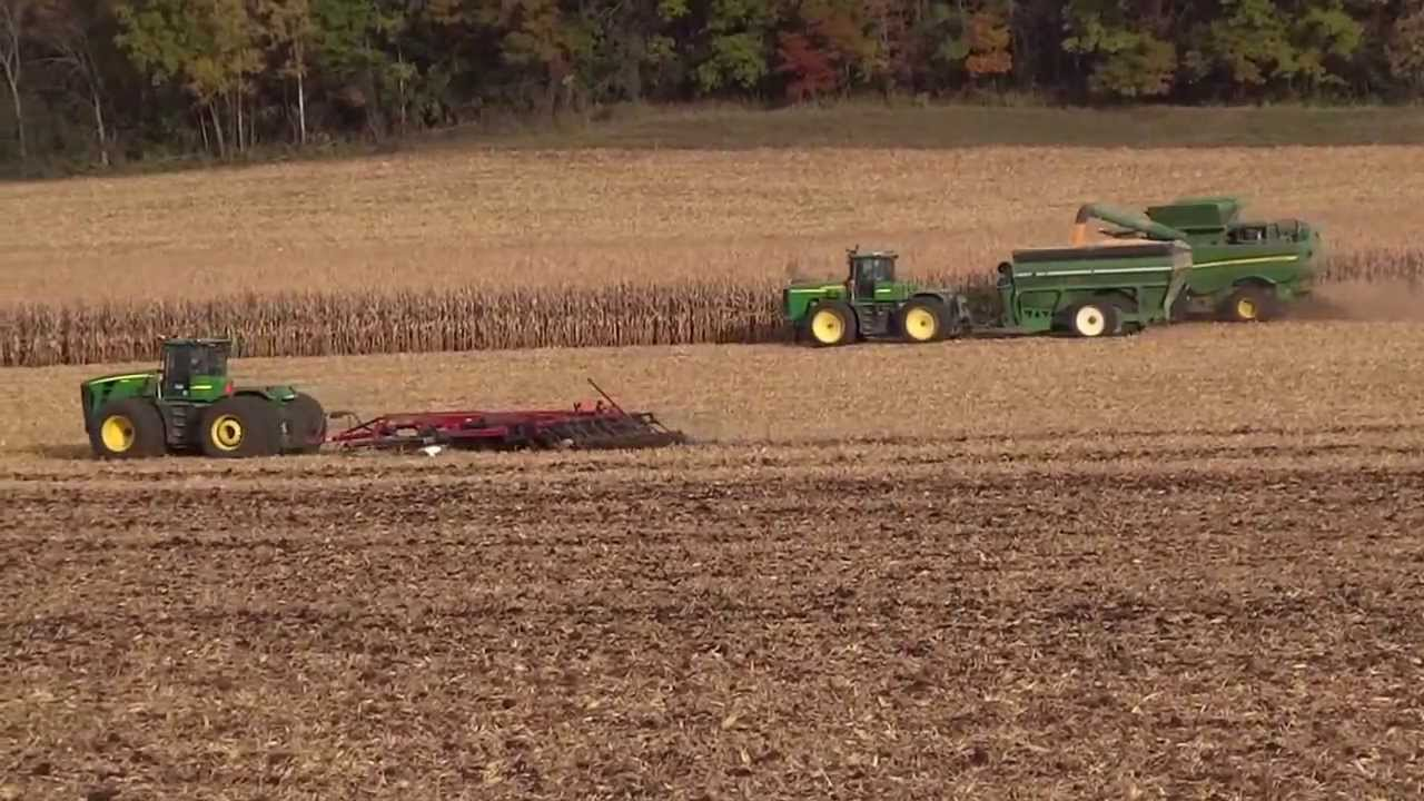 John Deere's in action! Combining Corn & Ripping the field ...