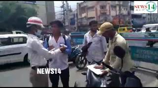 TRAFFIC POLICE SPECIAL CHECKING VEHICLE WITHOUT DOC HELMETS UNDER AGE,....NEWS14