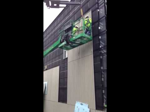 Installing exterior high performance concrete panels to Hamilton College in Syracuse NY