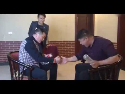 Funny Chinese people playing rock, paper, & scissors