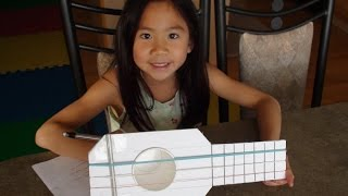 How to make a home-made guitar using foam board and rubber bands