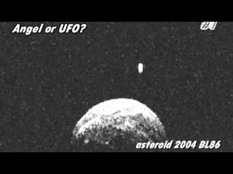 UFO or Angel? Mysterious object, diamond-shaped, protects the Earth from asteroid BL86 2004