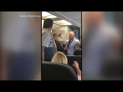American Airlines | Mom crying during confrontation with flight attendant