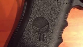 Laser Engraving The Punisher Logo on handle of a 40 glock gun with ULS 75 WATT  Marvin Faber