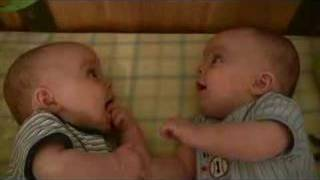 Twin Baby Boys Laughing at Each Other thumbnail