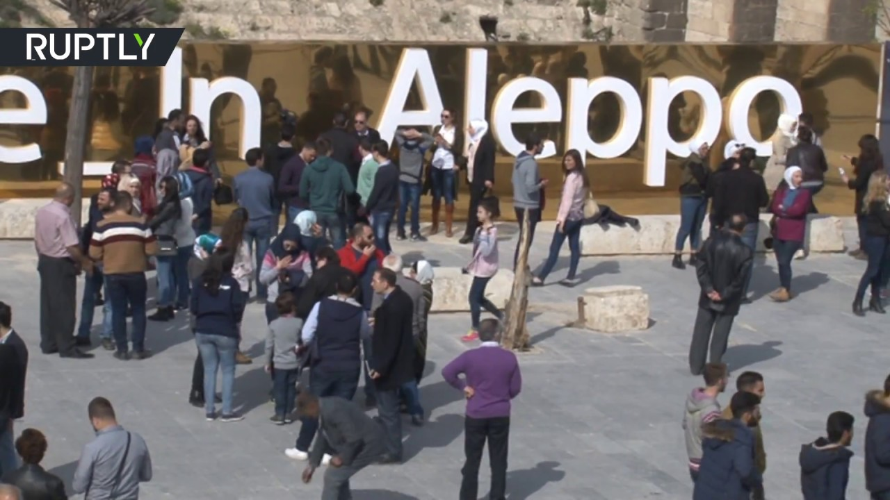 'Believe in Aleppo': Syrians cheer as inspiring monument unveiled in recaptured city