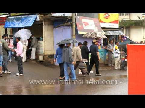 We met under an umbrella - old couples tour Panchgani market
