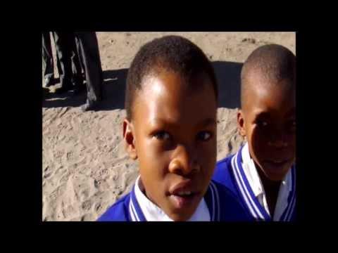 WorldwideXplorer® Botswana safaris sometimes stop at schools to help rural children