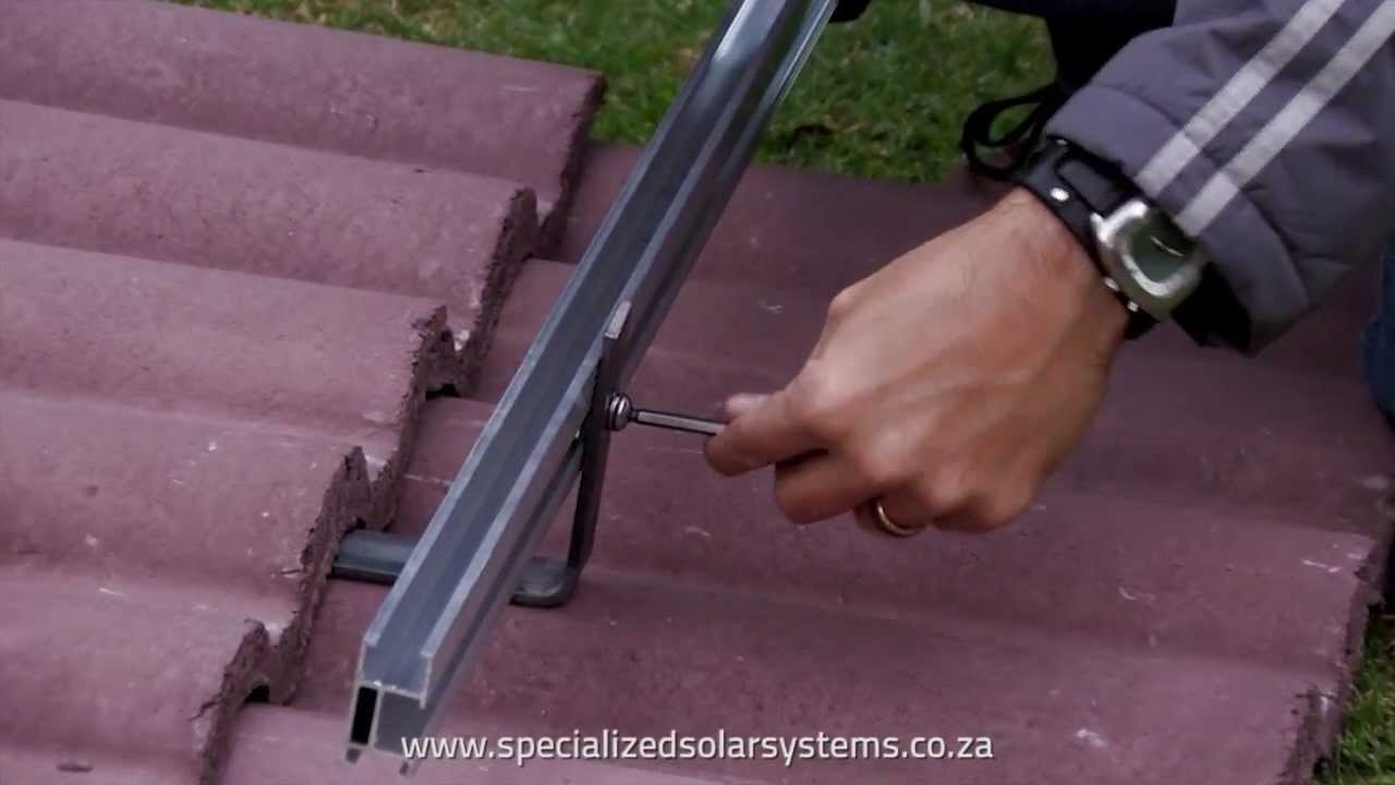 sss mounting a rail bracket system on roof tiles for solar rooftop diy