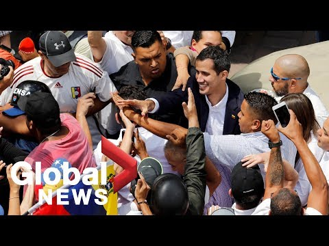 Juan Guaido swarmed by supporters at anti-Maduro rally after return to Venezuela