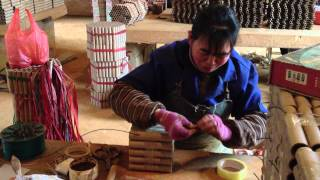 INSIDE A FIREWORK FACTORY - WORKER MAKING CAKES