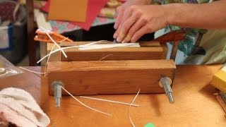 Using a handmade edge plow on a book
