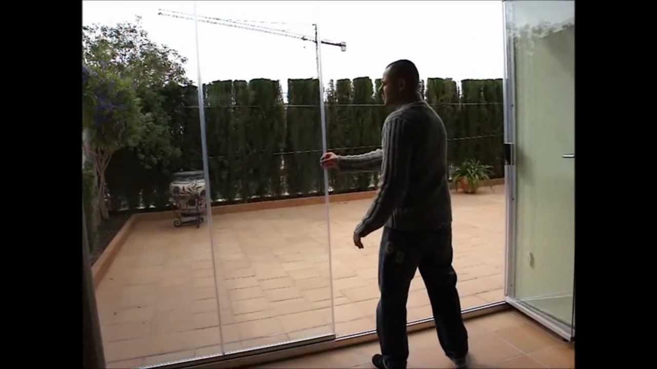 Cortina de cristal cerramiento sin perfiles verticales - Cortinas para puertas de cristal ...