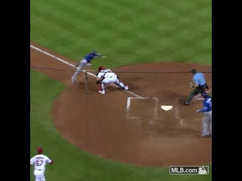 CHRIS COGHLAN JUMPS OVER YADIER MOLINA AND IS SAFE AT HOME PLATE