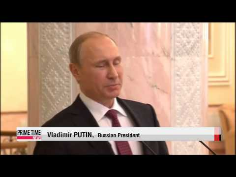 Putin announces Ukraine ceasefire starting on Feb. 15   민스크 4자 정상회담... 우크라 사태 해법