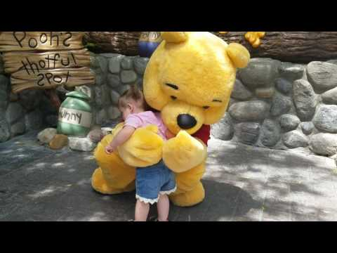Baby girl meets Winnie the Pooh