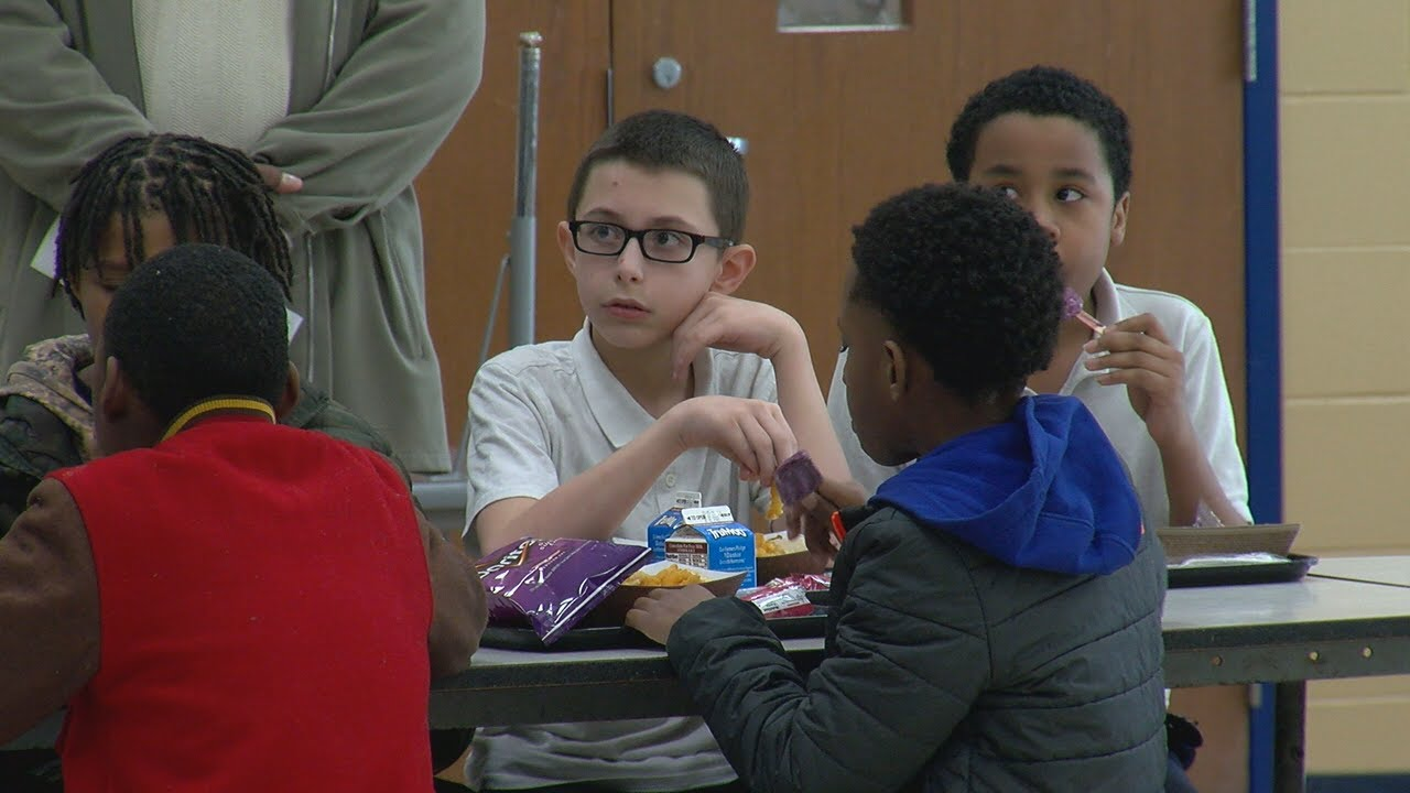 Love Lesson: Children learn friendship by sharing meal