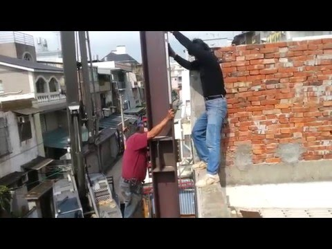 Cement rendering and installation of building structure H steel beam