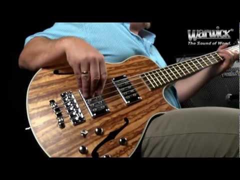 Andy Irvine jamming on a Warwick Star Bass Singlecut Tigerwood